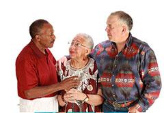 3 elderly people talking